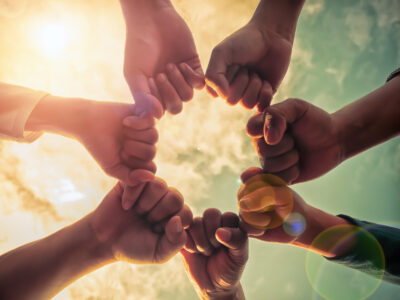Business group with hands together, teamwork concepts